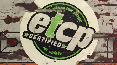 A distressed looking sticker with the ETCP logo on it.