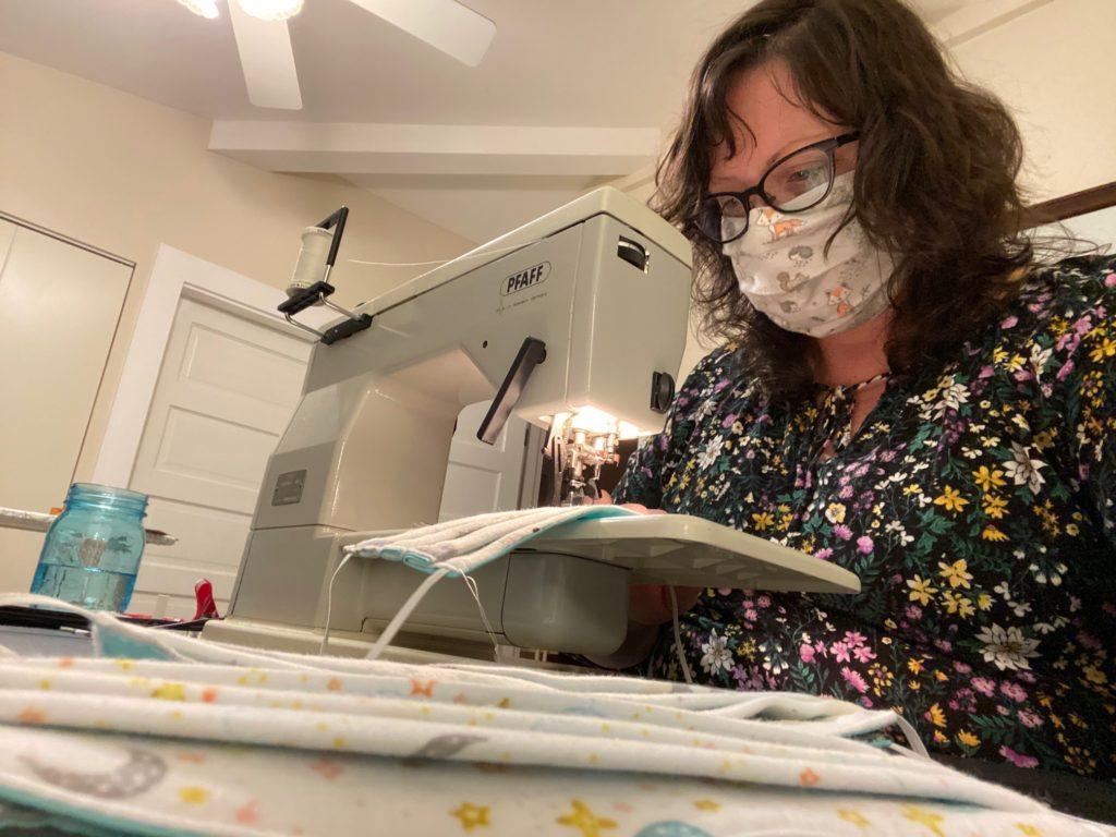 Member Janet Cadmus sewing masks