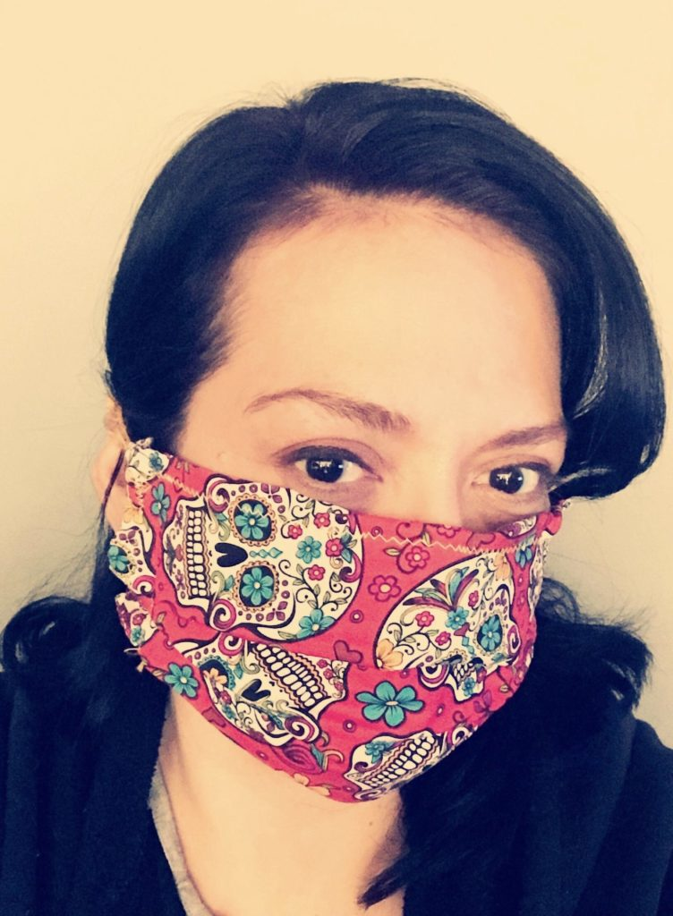 Pictured here is Audio Engineer Katherine Gonzalez wearing her mask.